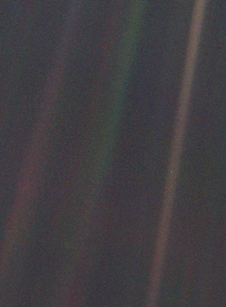 A picture of space, where the earth is a single tiny blue pixel in the deep darkness.